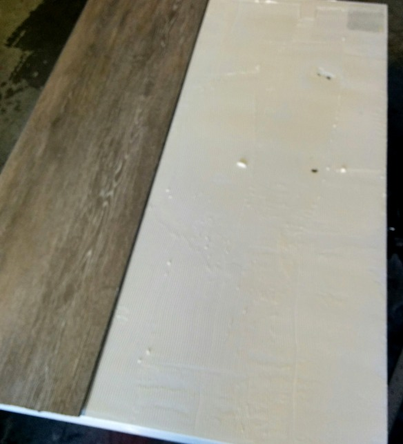 Placing the vinyl flooring on the refrigerator door.